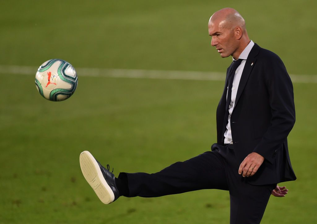 MADRID, SPAIN - JULY 16: Madrid coach Zinédine Zidane controls the ball during the Liga match between Real Madrid CF and Villarreal CF at Estadio Alfredo Di Stefano on July 16, 2020 in Madrid, Spain. (Photo by Denis Doyle/Getty Images)