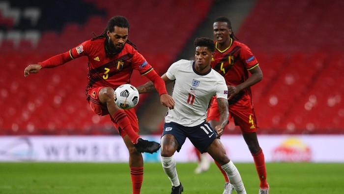 LONDON, ENGLAND - OCTOBER 11: Jason Denayer of Belgium  battles for possession with  Marcus Rashford of England  as Dedryck Boyata of Belgium looks on during the UEFA Nations League group stage match between England and Belgium at Wembley Stadium on October 11, 2020 in London, England. Football Stadiums around Europe remain empty due to the Coronavirus Pandemic as Government social distancing laws prohibit fans inside venues resulting in fixtures being played behind closed doors. (Photo by Neil Hall - Pool/Getty Images)