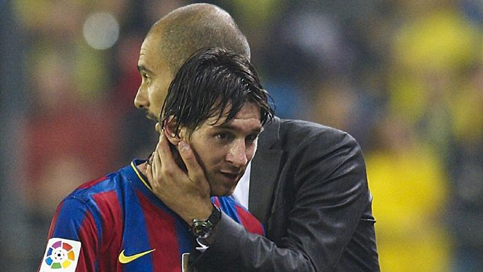 VILLARREAL, SPAIN - MAY 01:  Head coach Josep Guardiola (R) of FC Barcelona embraces Lionel Messi during the La Liga match between Villarreal CF and FC Barcelona at El Madrigal stadium on May 1, 2010 in Villarreal, Spain.  (Photo by Manuel Queimadelos Alonso/Getty Images)
