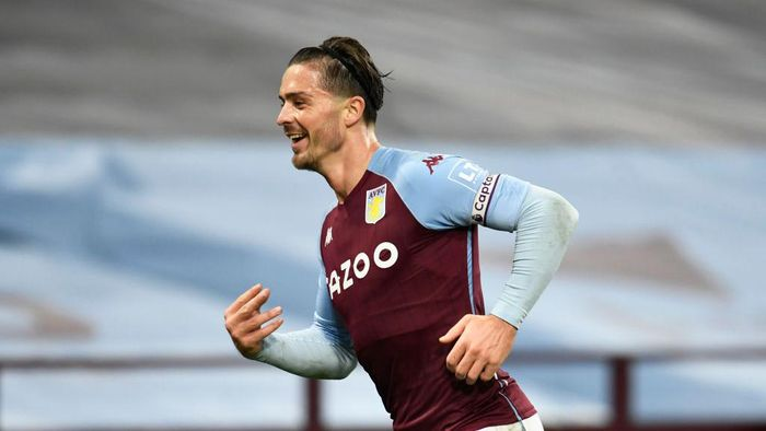 BIRMINGHAM, ENGLAND - OCTOBER 04: Jack Grealish of Aston Villa  celebrates after scoring his teams seventh goal  during the Premier League match between Aston Villa and Liverpool at Villa Park on October 04, 2020 in Birmingham, England. Sporting stadiums around the UK remain under strict restrictions due to the Coronavirus Pandemic as Government social distancing laws prohibit fans inside venues resulting in games being played behind closed doors. (Photo by Peter Powell - Pool/Getty Images)