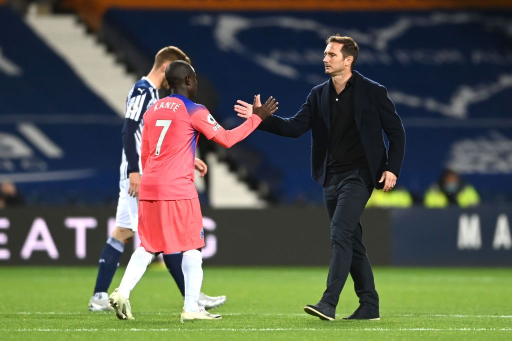WEST BROMWICH, ENGLAND - SEPTEMBER 26: Frank Lampard, Manager of Chelsea and Ngolo Kante of Chelsea interact following their draw in the Premier League match between West Bromwich Albion and Chelsea at The Hawthorns on September 26, 2020 in West Bromwich, England. Sporting stadiums around the UK remain under strict restrictions due to the Coronavirus Pandemic as Government social distancing laws prohibit fans inside venues resulting in games being played behind closed doors. (Photo by Laurence Griffiths/Getty Images)