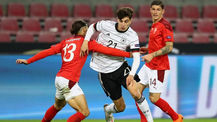 COLOGNE, GERMANY - OCTOBER 13: Kai Havertz of Germany is challenged by Ricardo Rodriguez of Switzerland during the UEFA Nations League group stage match between Germany and Switzerland at RheinEnergieStadion on October 13, 2020 in Cologne, Germany. Football Stadiums around Europe remain empty due to the Coronavirus Pandemic as Government social distancing laws prohibit fans inside venues resulting in fixtures being played behind closed doors. (Photo by Martin Rose/Getty Images)