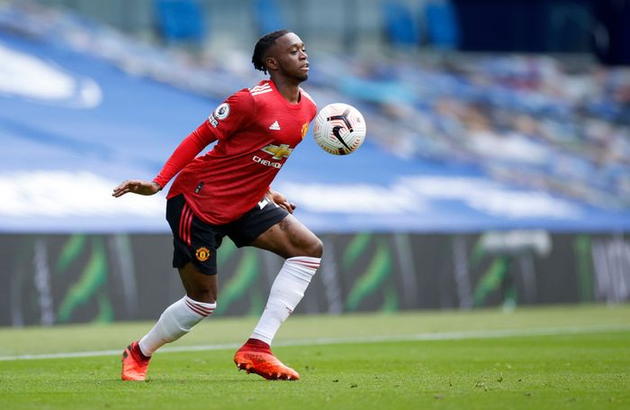 BRIGHTON, ENGLAND - SEPTEMBER 26: Aaron Wan-Bissaka of Manchester United controls the ball during the Premier League match between Brighton & Hove Albion and Manchester United at American Express Community Stadium on September 26, 2020 in Brighton, England. Sporting stadiums around the UK remain under strict restrictions due to the Coronavirus Pandemic as Government social distancing laws prohibit fans inside venues resulting in games being played behind closed doors. (Photo by John Sibley - Pool/Getty Images)