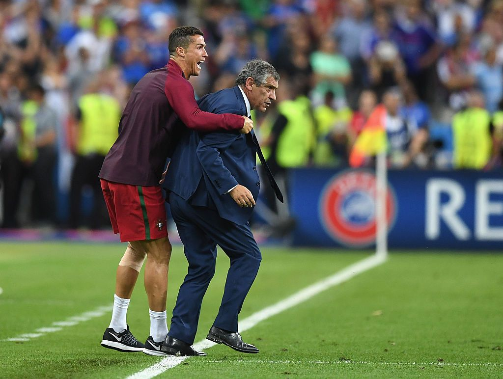 PARIS, FRANCE - JULY 10:  Manager Fernando Santos and Cristiano Ronaldo of Portugal celebrate winning at the final whistle during the UEFA EURO 2016 Final match between Portugal and France at Stade de France on July 10, 2016 in Paris, France.  (Photo by Laurence Griffiths/Getty Images)
