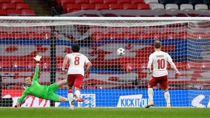 LONDON, ENGLAND - OCTOBER 14: Christian Eriksen of Denmark scores his teams first goal from the penalty spot past Jordan Pickford of England during the UEFA Nations League group stage match between England and Denmark at Wembley Stadium on October 14, 2020 in London, England. Football Stadiums around Europe remain empty due to the Coronavirus Pandemic as Government social distancing laws prohibit fans inside venues resulting in fixtures being played behind closed doors. (Photo by Toby Melville - Pool/Getty Images)