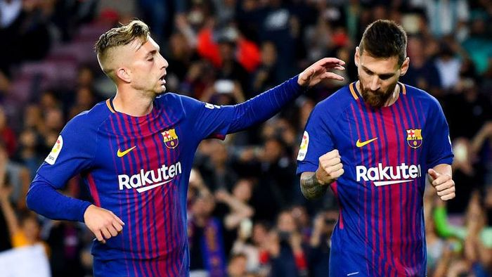 BARCELONA, SPAIN - SEPTEMBER 19:  Lionel Messi of FC Barcelona celebrates with his team mate Gerard Deulofeu of FC Barcelona after scoring his teams first goal from the penalty spot during the La Liga match between Barcelona and SD Eibar at Camp Nou on September 19, 2017 in Barcelona, Spain.  (Photo by David Ramos/Getty Images)