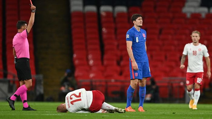 LONDON, ENGLAND - OCTOBER 14: Harry Maguire of England is shown the red card after getting a second yellow card during the UEFA Nations League group stage match between England and Denmark at Wembley Stadium on October 14, 2020 in London, England. Football Stadiums around Europe remain empty due to the Coronavirus Pandemic as Government social distancing laws prohibit fans inside venues resulting in fixtures being played behind closed doors. (Photo by Daniel Leal Olivas - Pool/Getty Images)