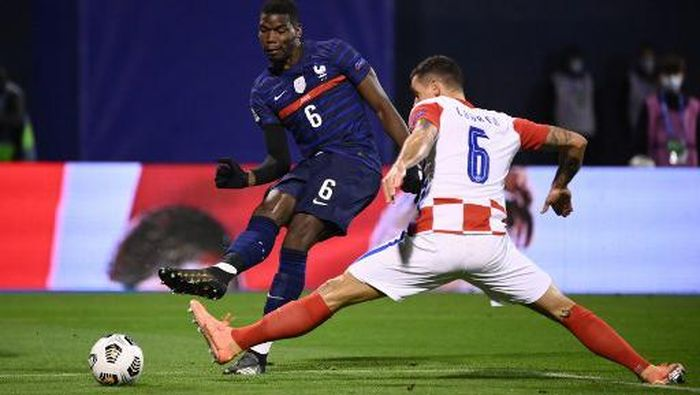 Frances midfielder Paul Pogba (O) vies for the ball with Croatias defender Dejan Lovren  during the UEFA Nations League Group A3 football match between Croatia and France at the Maksimir Stadium in Zagreb on October 14, 2020. (Photo by FRANCK FIFE / AFP)