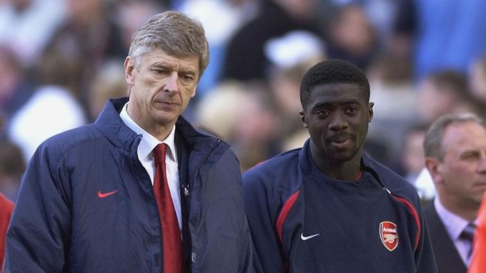BIRMINGHAM - APRIL 5:  Arsenal manager Arsene Wenger looks dejected as he leaves the field with Kolo Toure of Arsenal during the FA Barclaycard Premiership match between Aston Villa and Arsenal held on April 5, 2003 at Villa Park in Birmingham.  The match was a 1-1 draw.  (Photo By Shaun Botterill/Getty Images)