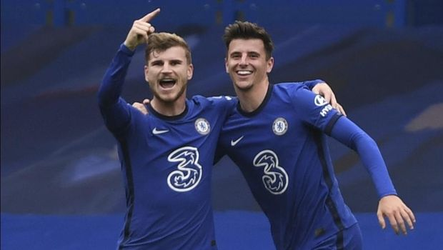 Chelsea's Timo Werner, left, celebrates after scoring his side's second goal during the English Premier League soccer match between Southampton and Chelsea at the Stamford Bridge in London, England, Saturday, Oct. 17, 2020.(Mike Hewitt/Pool via AP)