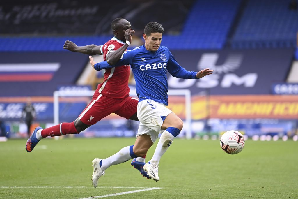 Everton's James Rodriguez, right, competes for the ball with Liverpool's Sadio Mane during the English Premier League soccer match between Everton and Liverpool at Goodison Park stadium, in Liverpool, England, Saturday, Oct. 17, 2020. (Laurence Griffiths/Pool via AP)