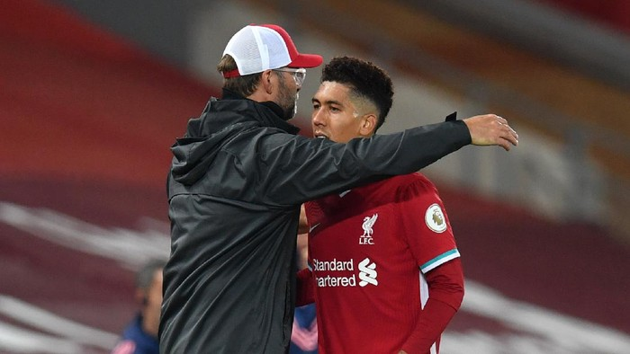 LIVERPOOL, ENGLAND - SEPTEMBER 28: Jurgen Klopp, Manager of Liverpool embraces Roberto Firminho during the Premier League match between Liverpool and Arsenal at Anfield on September 28, 2020 in Liverpool, England. Sporting stadiums around the UK remain under strict restrictions due to the Coronavirus Pandemic as Government social distancing laws prohibit fans inside venues resulting in games being played behind closed doors. (Photo by Paul Ellis - Pool/Getty Images)