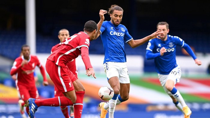 LIVERPOOL, ENGLAND - OCTOBER 17: Dominic Calvert-Lewin of Everton battles for possession with Joel Matip of Liverpool during the Premier League match between Everton and Liverpool at Goodison Park on October 17, 2020 in Liverpool, England. Sporting stadiums around the UK remain under strict restrictions due to the Coronavirus Pandemic as Government social distancing laws prohibit fans inside venues resulting in games being played behind closed doors. (Photo by Laurence Griffiths/Getty Images)