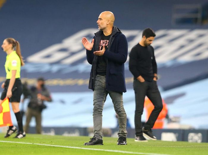 MANCHESTER, ENGLAND - OCTOBER 17: Pep Guardiola, Manager of Manchester City reacts during the Premier League match between Manchester City and Arsenal at Etihad Stadium on October 17, 2020 in Manchester, England. Sporting stadiums around the UK remain under strict restrictions due to the Coronavirus Pandemic as Government social distancing laws prohibit fans inside venues resulting in games being played behind closed doors. (Photo by Alex Livesey/Getty Images)