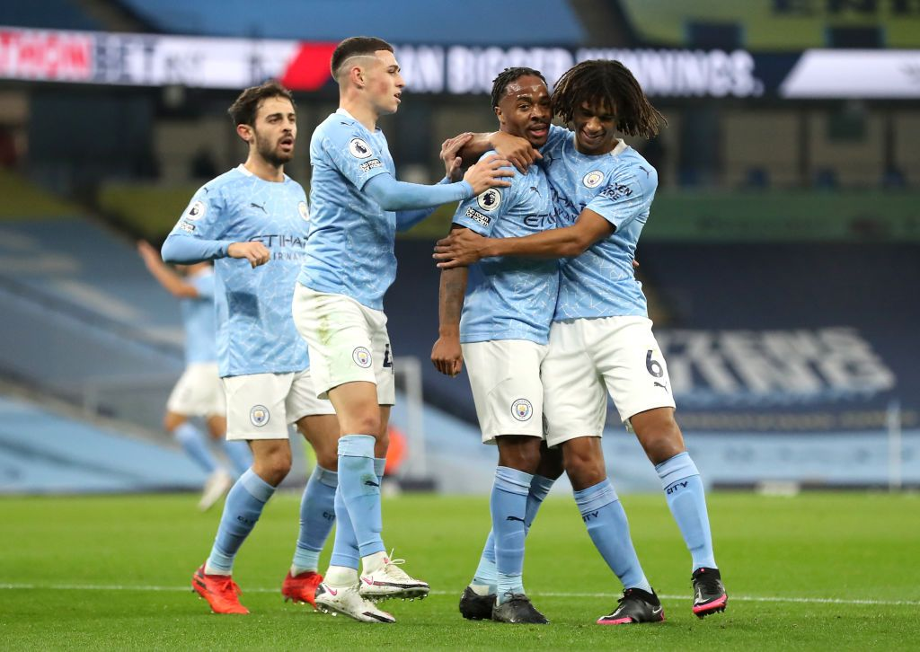 MANCHESTER, ENGLAND - OCTOBER 17: Raheem Sterling of Manchester City celebrates with teammates after scoring his team's first goal during the Premier League match between Manchester City and Arsenal at Etihad Stadium on October 17, 2020 in Manchester, England. Sporting stadiums around the UK remain under strict restrictions due to the Coronavirus Pandemic as Government social distancing laws prohibit fans inside venues resulting in games being played behind closed doors. (Photo by Martin Rickett - Pool/Getty Images)
