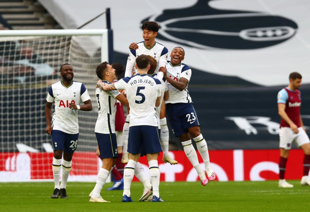 LONDON, ENGLAND - OCTOBER 18: Heung-Min Son of Tottenham Hotspur celebrates with teammates after scoring his team's first goal during the Premier League match between Tottenham Hotspur and West Ham United at Tottenham Hotspur Stadium on October 18, 2020 in London, England. Sporting stadiums around the UK remain under strict restrictions due to the Coronavirus Pandemic as Government social distancing laws prohibit fans inside venues resulting in games being played behind closed doors. (Photo by Clive Rose/Getty Images)