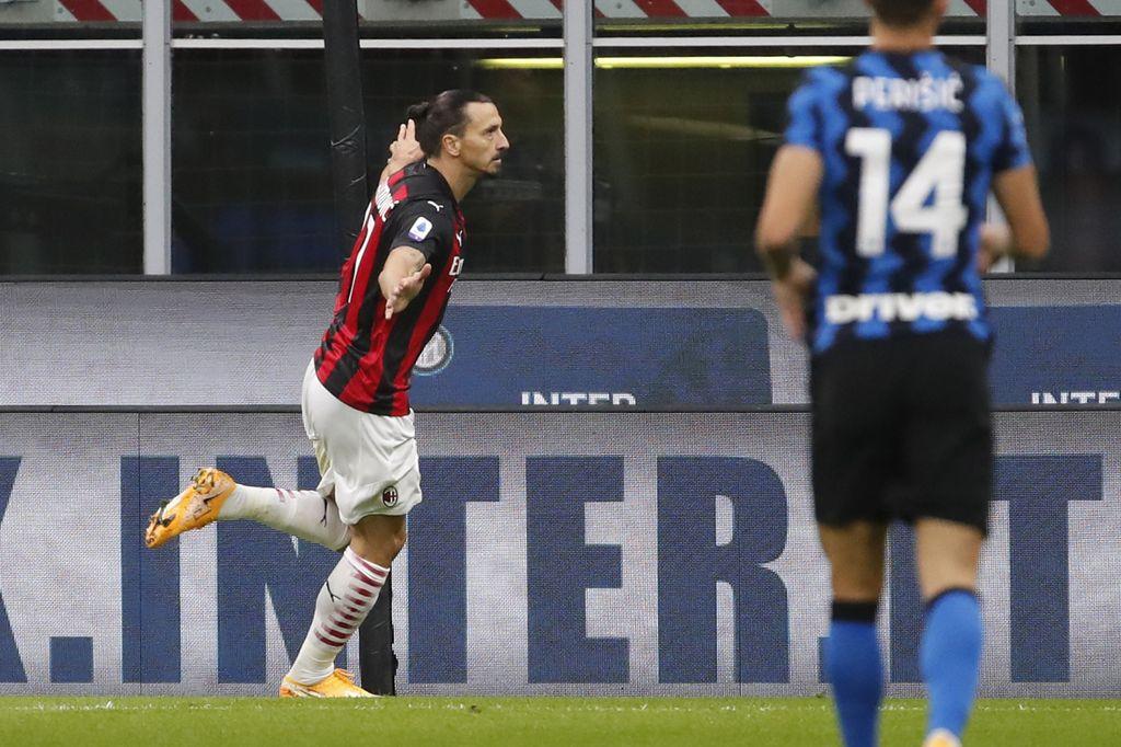 AC Milan's Zlatan Ibrahimovic celebrates after scoring his side's second goal during the Serie A soccer match between Inter Milan and AC Milan at the San Siro Stadium, in Milan, Italy, Saturday, Oct. 17, 2020. (AP Photo/Antonio Calanni)
