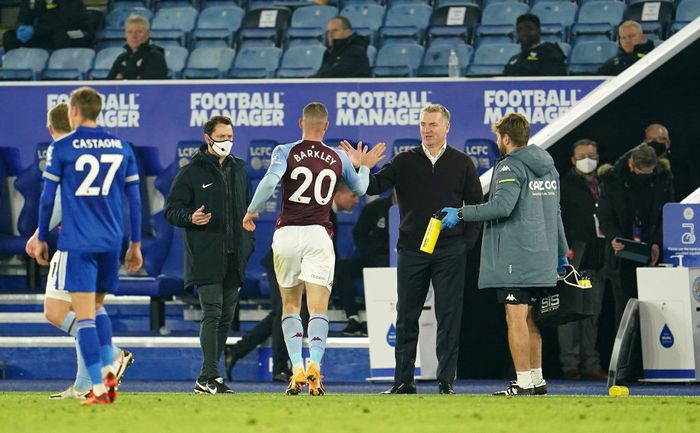 LEICESTER, ENGLAND - OCTOBER 18: Dean Smith, Manager of Aston Villa and Ross Barkley of Aston Villa celebrate following their sides victory in the Premier League match between Leicester City and Aston Villa at The King Power Stadium on October 18, 2020 in Leicester, England. Sporting stadiums around the UK remain under strict restrictions due to the Coronavirus Pandemic as Government social distancing laws prohibit fans inside venues resulting in games being played behind closed doors. (Photo by Jon Super - Pool/Getty Images)