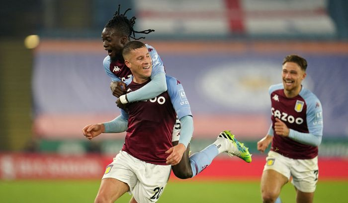 LEICESTER, ENGLAND - OCTOBER 18: Ross Barkley of Aston Villa celebrates with teammates Bertrand Traore and Matty Cash after scoring his teams first goal during the Premier League match between Leicester City and Aston Villa at The King Power Stadium on October 18, 2020 in Leicester, England. Sporting stadiums around the UK remain under strict restrictions due to the Coronavirus Pandemic as Government social distancing laws prohibit fans inside venues resulting in games being played behind closed doors. (Photo by Jon Super - Pool/Getty Images)
