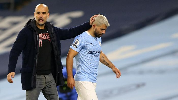 Manchester Citys Sergio Aguero passes by Manchester Citys head coach Pep Guardiola after being substituted during the English Premier League soccer match between Manchester City and Arsenal at the Etihad stadium in Manchester, England, Saturday, Oct. 17, 2020. (Alex Livesey/Pool via AP)