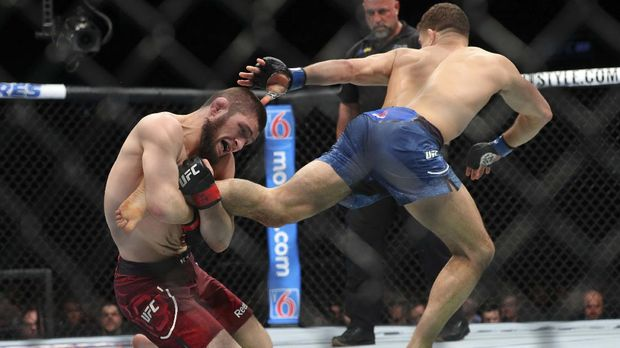 NEW YORK, NY - APRIL 07: Khabib Nurmagomedov (L) attempts a takedown on Al Iaquinta (R) during their UFC lightweight championship bout at UFC 223 at Barclays Center on April 7, 2018 in New York City.   Ed Mulholland/Getty Images/AFP