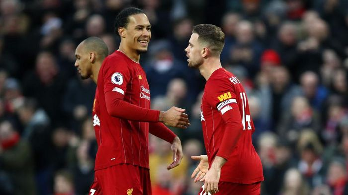 LIVERPOOL, ENGLAND - FEBRUARY 01: Jordan Henderson of Liverpool celebrates with Virgil van Dijk after scoring his teams second goal during the Premier League match between Liverpool FC and Southampton FC at Anfield on February 01, 2020 in Liverpool, United Kingdom. (Photo by Julian Finney/Getty Images)