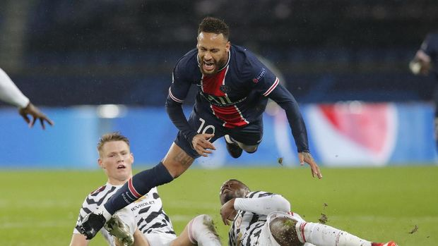 PSG's Neymar is sent flying by a challenge during the Champions League group H soccer match between Paris Saint-Germain and Manchester United at the Parc des Princes in Paris, France, Tuesday, Oct. 20, 2020. (AP Photo/Michel Euler)