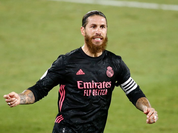 SEVILLE, SPAIN - SEPTEMBER 26: Sergio Ramos of Real Madrid celebrates after scoring his teams third goal from the penalty spot during the La Liga Santander match between Real Betis and Real Madrid at Estadio Benito Villamarin on September 26, 2020 in Seville, Spain. Sporting stadiums in Spain remain under strict restrictions due to the Coronavirus Pandemic as Government social distancing laws prohibit fans inside venues resulting in games being played behind closed doors. (Photo by Fran Santiago/Getty Images)