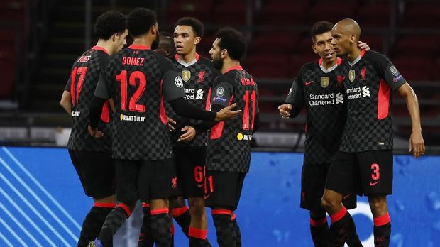 Liverpool's Trent Alexander-Arnold, center, no 66, celebrates with teammates after scoring during the group D Champions League soccer match between Ajax and Liverpool at the Johan Cruyff ArenA in Amsterdam, Netherlands, Wednesday, Oct. 21, 2020. (AP Photo/Peter Dejong)