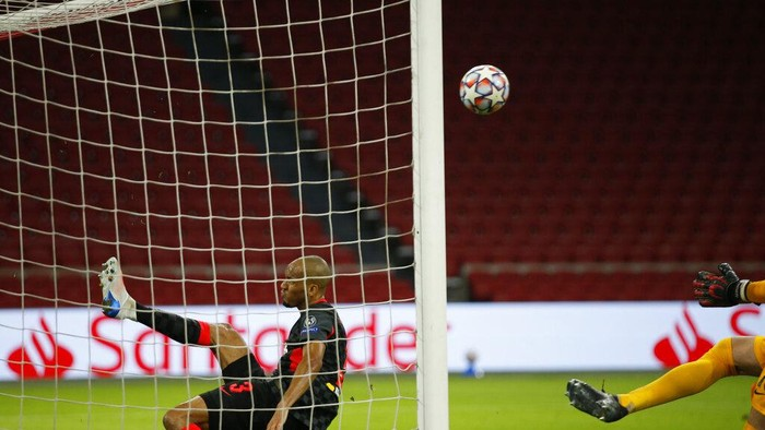 Liverpools Fabinho, saves from the goal line after a header from Ajaxs captain Dusan Tadic from scoring during the group D Champions League soccer match between Ajax and Liverpool at the Johan Cruyff ArenA in Amsterdam, Netherlands, Wednesday, Oct. 21, 2020. (AP Photo/Peter Dejong)