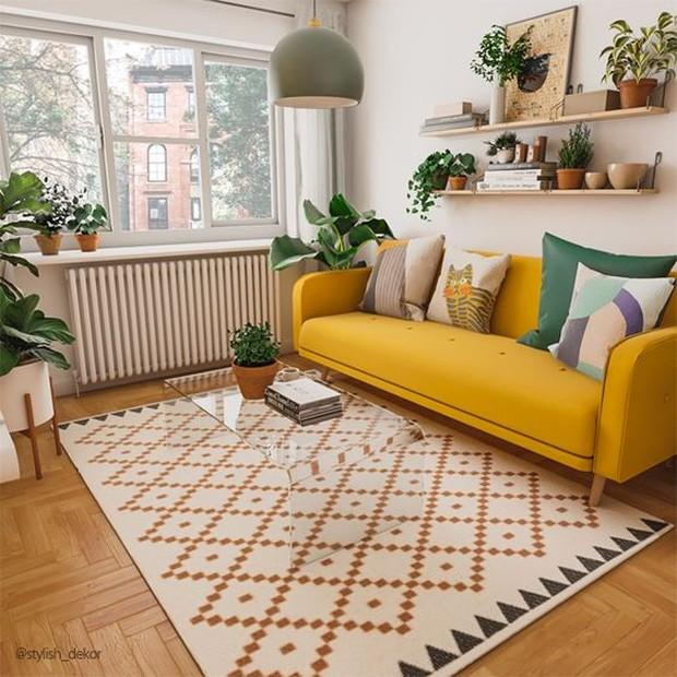 Melapisi lantai ruangan dengan karpet dapat membantu menghidupkan ruangan.