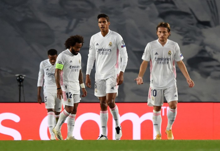 MADRID, SPAIN - OCTOBER 21: Marcelo of Real Madrid and teammates look dejected after conceding a third goal during the UEFA Champions League Group B stage match between Real Madrid and Shakhtar Donetsk at Estadio Alfredo Di Stefano on October 21, 2020 in Madrid, Spain. The game will be played behind closed doors as a COVID-19 precaution.  (Photo by Denis Doyle/Getty Images)