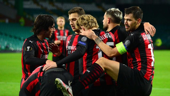 GLASGOW, SCOTLAND - OCTOBER 22: Jens Petter Hauge of AC Milan celebrates after scoring his sides third goal  during the UEFA Europa League Group H stage match between Celtic and AC Milan at Celtic Park on October 22, 2020 in Glasgow, Scotland. Sporting stadiums around the UK remain under strict restrictions due to the Coronavirus Pandemic as Government social distancing laws prohibit fans inside venues resulting in games being played behind closed doors. (Photo by Mark Runnacles/Getty Images)