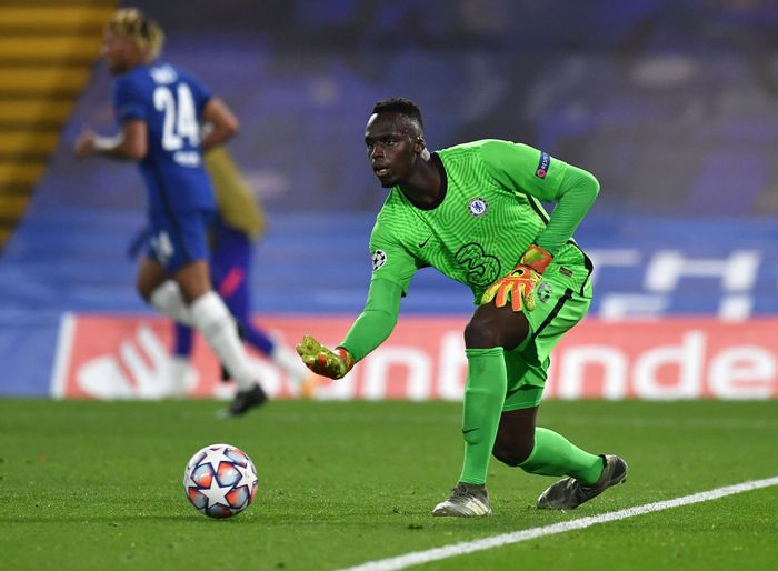 LONDON, ENGLAND - OCTOBER 20: Edouard Mendy of Chelsea rolls the ball out during the UEFA Champions League Group E stage match between Chelsea FC and FC Sevilla at Stamford Bridge on October 20, 2020 in London, England. Sporting stadiums around the UK remain under strict restrictions due to the Coronavirus Pandemic as Government social distancing laws prohibit fans inside venues resulting in games being played behind closed doors. (Photo by Glyn Kirk - Pool/Getty Images)