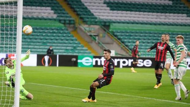 AC Milan's Bosnian midfielder Rade Krunic (unseen) scores his team's first goal during the UEFA Europa League 1st round group H football match between Celtic and AC Milan at Celtic Park stadium in Glasgow, Scotland on October 22, 2020. - sch (Photo by RUSSELL CHEYNE / POOL / AFP)