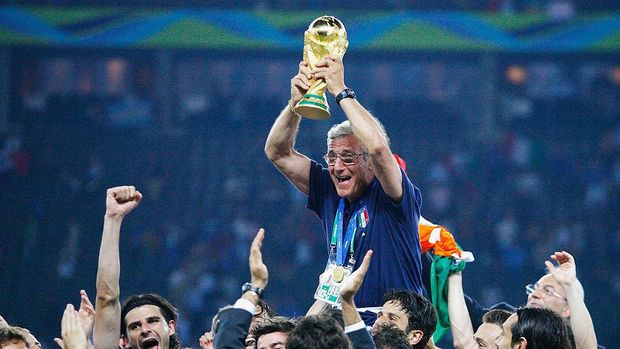 BERLIN - JULY 09:  The Italian players celebrate as Marcello Lippi the coach of Italy lifts the World Cup trophy aloft following his team's victory in a penalty shootout at the end of the FIFA World Cup Germany 2006 Final match between Italy and France at the Olympic Stadium on July 9, 2006 in Berlin, Germany.  (Photo by Shaun Botterill/Getty Images)