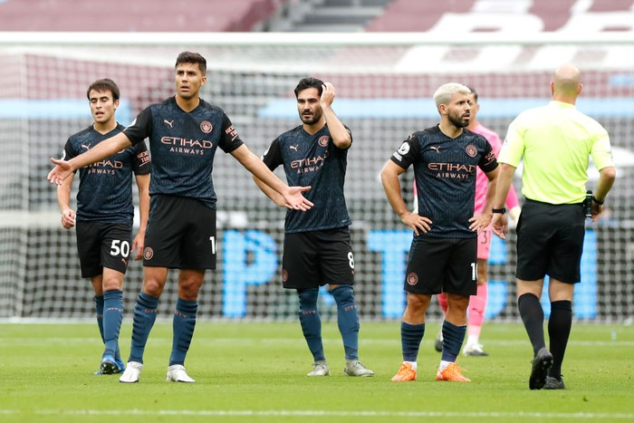 LONDON, ENGLAND - OCTOBER 24: Rodrigo of Manchester City reacts during the Premier League match between West Ham United and Manchester City at London Stadium on October 24, 2020 in London, England. Sporting stadiums around the UK remain under strict restrictions due to the Coronavirus Pandemic as Government social distancing laws prohibit fans inside venues resulting in games being played behind closed doors. (Photo by Paul Childs - Pool/Getty Images)
