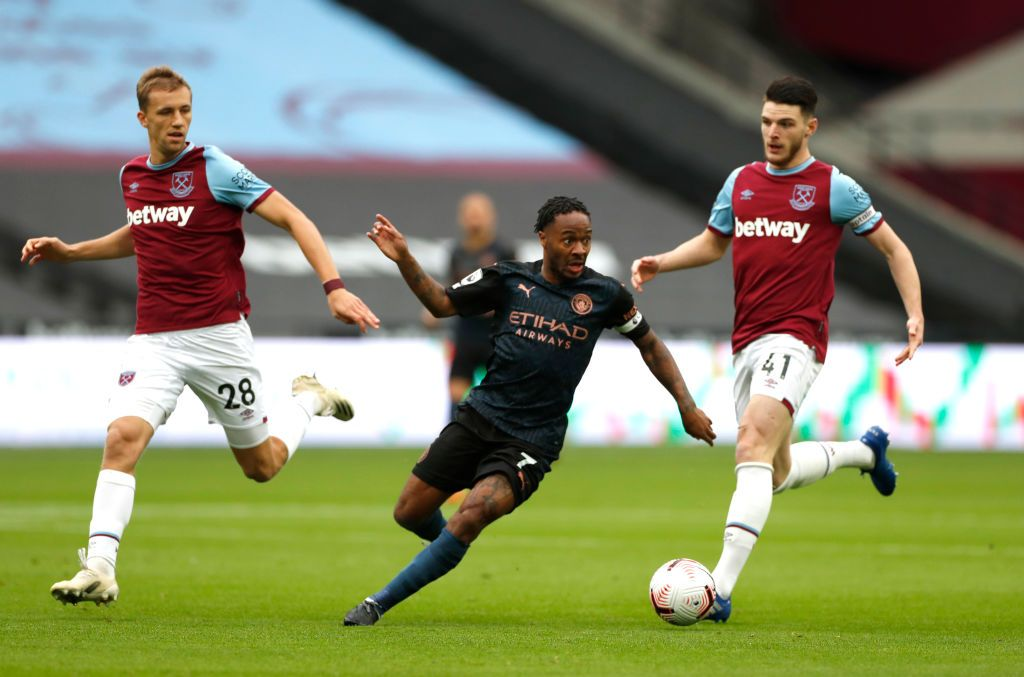 LONDON, ENGLAND - OCTOBER 24: Eric Garcia of Manchester City  battles for possession with  Michail Antonio of West Ham United  during the Premier League match between West Ham United and Manchester City at London Stadium on October 24, 2020 in London, England. Sporting stadiums around the UK remain under strict restrictions due to the Coronavirus Pandemic as Government social distancing laws prohibit fans inside venues resulting in games being played behind closed doors. (Photo by Justin Tallis - Pool/Getty Images)
