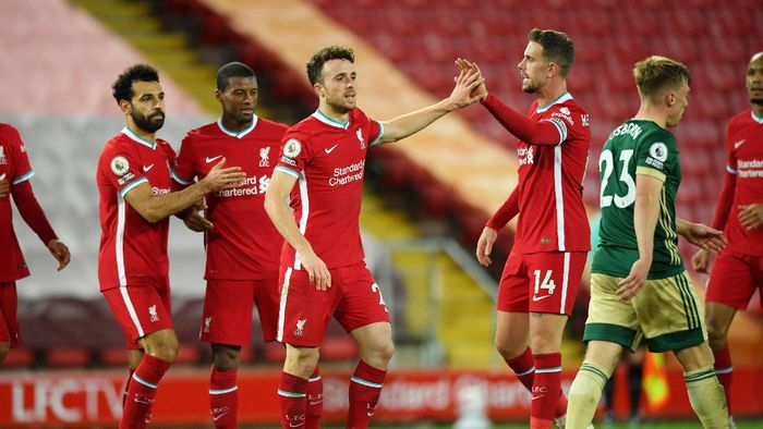 LIVERPOOL, ENGLAND - OCTOBER 24: Diogo Jota of Liverpool celebrates with teammates after scoring his teams second goal during the Premier League match between Liverpool and Sheffield United at Anfield on October 24, 2020 in Liverpool, England. Sporting stadiums around the UK remain under strict restrictions due to the Coronavirus Pandemic as Government social distancing laws prohibit fans inside venues resulting in games being played behind closed doors. (Photo by Stu Forster/Getty Images)