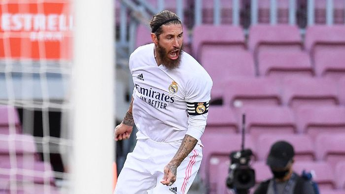 BARCELONA, SPAIN - OCTOBER 24: Sergio Ramos of Real Madrid celebrates after scoring his teams second goal during the La Liga Santander match between FC Barcelona and Real Madrid at Camp Nou on October 24, 2020 in Barcelona, Spain. Sporting stadiums around Spain remain under strict restrictions due to the Coronavirus Pandemic as Government social distancing laws prohibit fans inside venues resulting in games being played behind closed doors. (Photo by Alex Caparros/Getty Images)