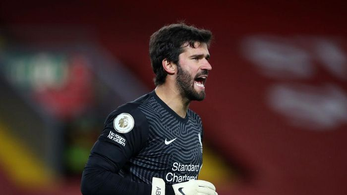 LIVERPOOL, ENGLAND - OCTOBER 24: Alisson Becker of Liverpool gives his team instructions during the Premier League match between Liverpool and Sheffield United at Anfield on October 24, 2020 in Liverpool, England. Sporting stadiums around the UK remain under strict restrictions due to the Coronavirus Pandemic as Government social distancing laws prohibit fans inside venues resulting in games being played behind closed doors. (Photo by Michael Steele/Getty Images)
