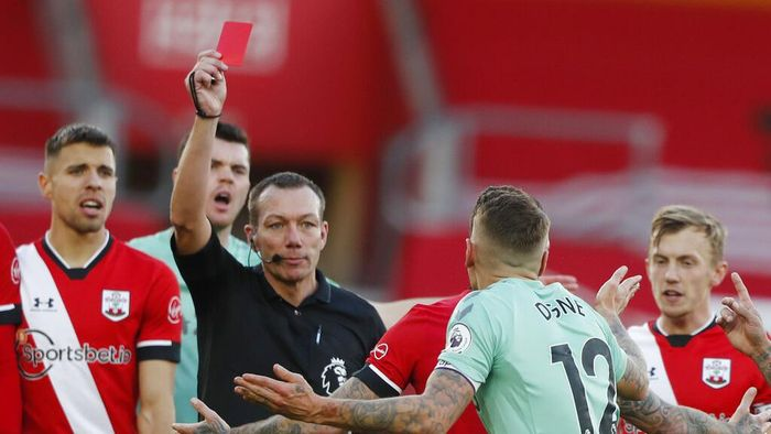 Evertons Lucas Digne, centre right, is shown a red card by the referee after a foul on Southamptons Kyle Walker-Peters during an English Premier League soccer match between Southampton and Everton at the St. Marys stadium in Southampton, England, Sunday Oct. 25, 2020. (AP Photo/Frank Augstein, Pool)
