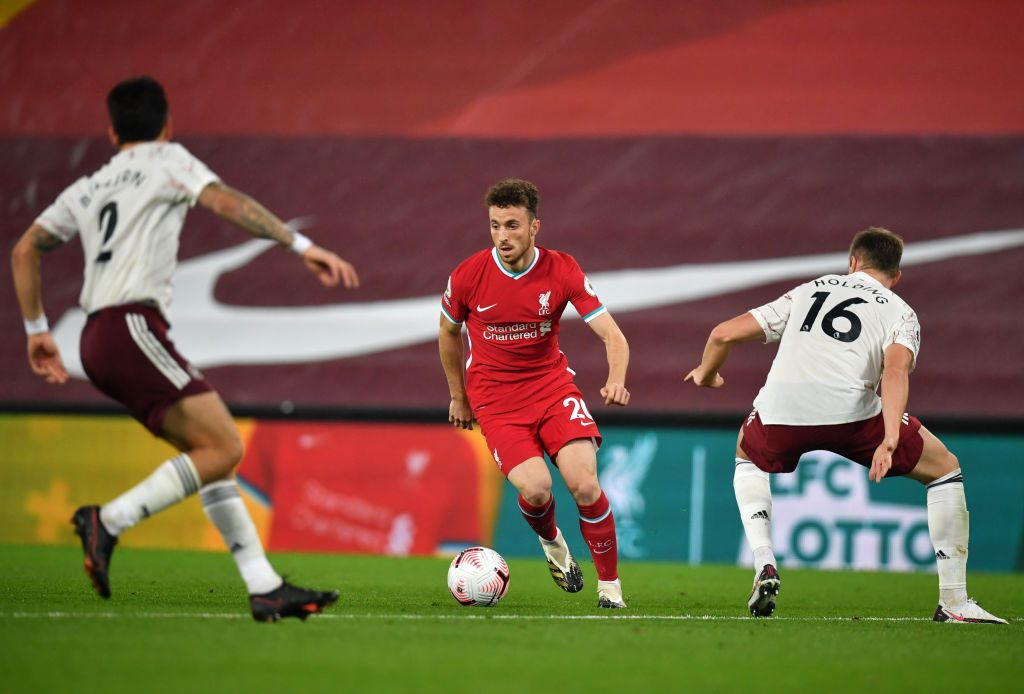 LIVERPOOL, ENGLAND - SEPTEMBER 28: Diogo Jota of Liverpool runs with the ball during the Premier League match between Liverpool and Arsenal at Anfield on September 28, 2020 in Liverpool, England. Sporting stadiums around the UK remain under strict restrictions due to the Coronavirus Pandemic as Government social distancing laws prohibit fans inside venues resulting in games being played behind closed doors. (Photo by Laurence Griffiths/Getty Images)