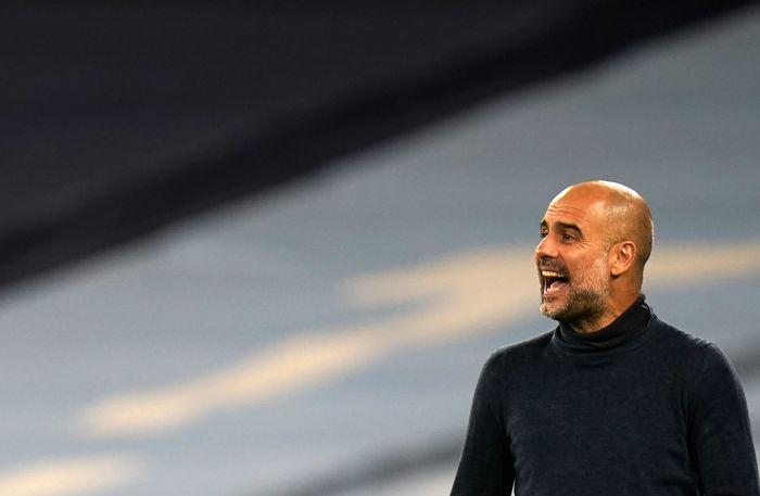 Manchester Citys head coach Pep Guardiola gives instructions to his players during the Champions League group C soccer match between Manchester City and FC Porto at the Etihad stadium in Manchester, England, Wednesday, Oct. 21, 2020. (Tim Keeton/Pool via AP)