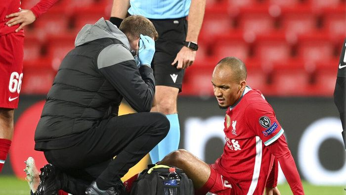 Liverpools Fabinho is treated for an injury during the Champions League Group D soccer match between Liverpool and FC Midtjylland at Anfield stadium, in Liverpool, England, Tuesday, Oct. 27, 2020. (Michael Regan/Pool via AP)