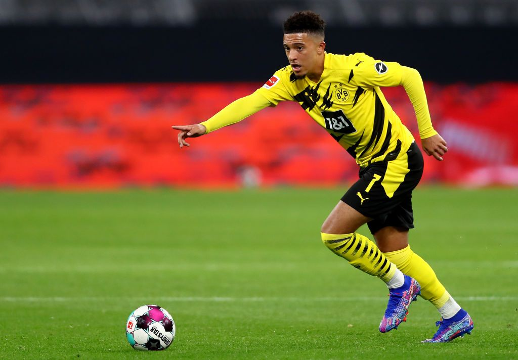 DORTMUND, GERMANY - OCTOBER 24: Jadon Sancho of Dortmund runs with the ball during the Bundesliga match between Borussia Dortmund and FC Schalke 04 at Signal Iduna Park on October 24, 2020 in Dortmund, Germany. A limited number of spectators (300) will be in attendance as Covid-19 pandemic restrictions are eased in Dortmund.  (Photo by Martin Rose/Getty Images)