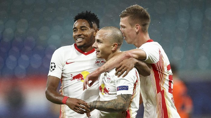 LEIPZIG, GERMANY - OCTOBER 20: Angelino of RB Leipzig celebrates with teammates after scoring his teams second goal during the UEFA Champions League Group H stage match between RB Leipzig and İstanbul Basaksehir at Red Bull Arena on October 20, 2020 in Leipzig, Germany. (Photo by Maja Hitij/Getty Images)