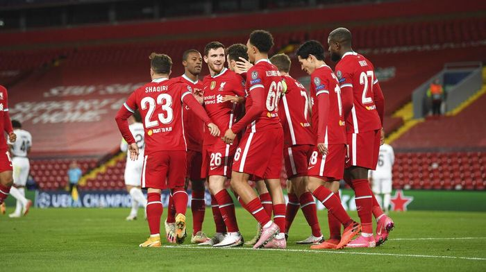 Liverpools Diogo Jota, fourth left obscured, celebrates scoring his sides first goal during the Champions League Group D soccer match between Liverpool and FC Midtjylland at Anfield stadium, in Liverpool, England, Tuesday, Oct. 27, 2020. (Michael Regan/Pool via AP)