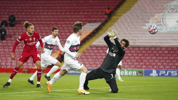 Midtjylland's Anders Dreyer, third left, hits a shot during the Champions League Group D soccer match between Liverpool and FC Midtjylland at Anfield stadium, in Liverpool, England, Tuesday, Oct. 27, 2020. (Jon Super/Pool via AP)