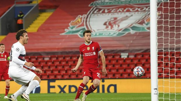 Liverpool's Diogo Jota, right, scores his side's first goal during the Champions League Group D soccer match between Liverpool and FC Midtjylland at Anfield stadium, in Liverpool, England, Tuesday, Oct. 27, 2020. (Michael Regan/Pool via AP)